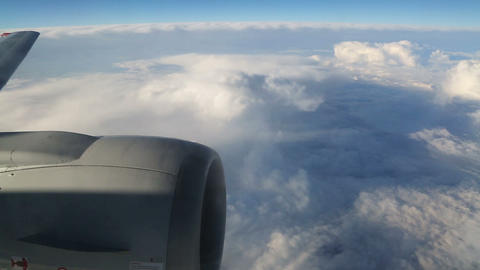 View From Airplane On Clouds Wing And Engine stock footage