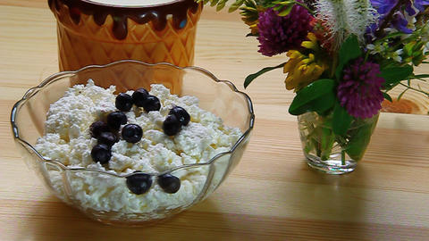 Blueberries mixed with cottage cheese in a bowl on Stock Video Footage