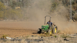 Tractor Working In Field stock footage