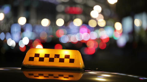 Illuminated Taxi Cab Sign On A City Street stock footage