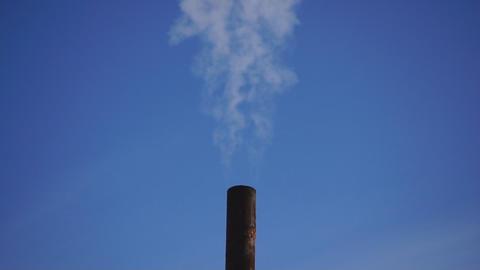 Smoke against blue sky 01 Stock Video Footage