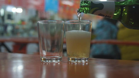 Beer into glasses Stock Video Footage