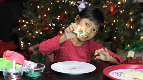 Asian Girl Adds Sprinkles To Christmas Cookie Footage