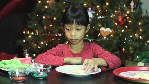 Asian Girl Decorating Christmas Cookie Stock Video Footage