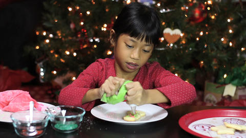 Christmas Snowman Cookie Gets Green Icing Stock Video Footage