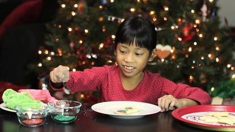 Girl Adds Sprinkles To Christmas Cookie Stock Video Footage