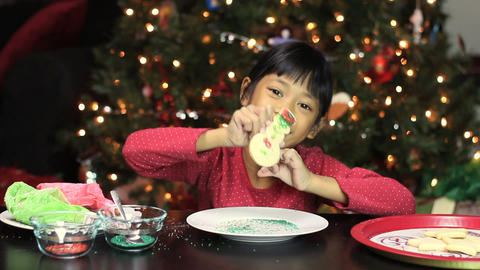 Girl Adds Sprinkles To Christmas Cookie Footage
