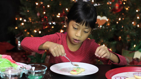 Asian Girl With Pretty Christmas Snowman Cookie Stock Video Footage