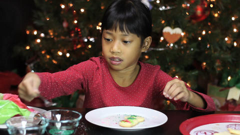 Asian Girl With Pretty Christmas Snowman Cookie Footage