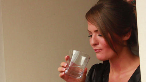 Girl Swallows a Pill and Drinks Water Footage