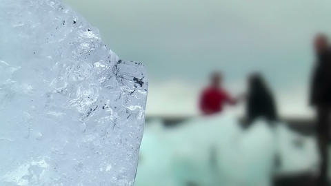 blue shimmering ice block at icelandic coast Stock Video Footage