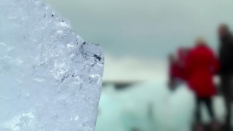 blue shimmering ice block at icelandic coast Stock Video Footage