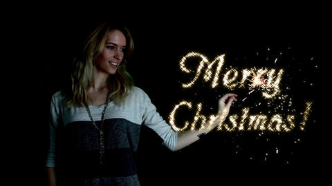 Girl Conjures Merry Christmas! stock footage