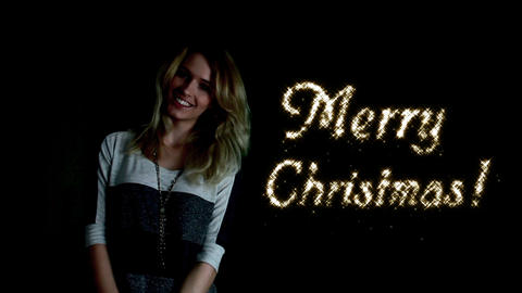 Girl conjures Merry christmas! Stock Video Footage
