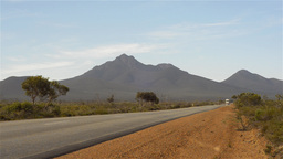 Road train travelling down a remote highway in Aus Stock Video Footage