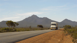 Road train travelling down a remote highway in Aus Footage