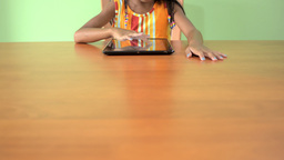Table with Young Asian Girl Using a Tablet PC Footage