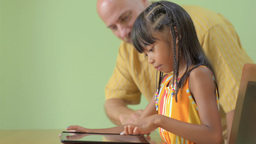 Father Helping Daughter Use an iPad Stock Video Footage