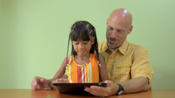 Father and Daughter Playing on a Tablet Computer T Stock Video Footage