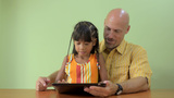 Father and Daughter Playing on a Tablet Computer T Footage