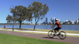 A woman exercising along the Swan River in Perth Footage