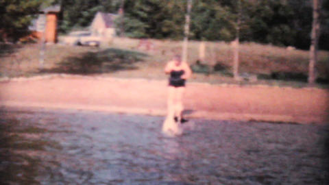 Happy Dog Enjoys Swimming In Lake 1962 Vintage 8mm Footage