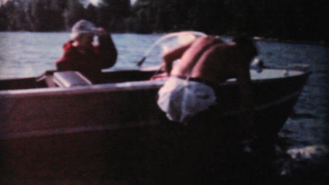 Happy Dog Enjoys Swimming In Lake 1962 Vintage 8mm Stock Video Footage
