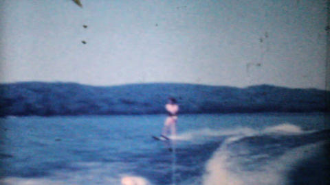 Woman Water Skiing On Lake-1962 Vintage 8mm film Stock Video Footage