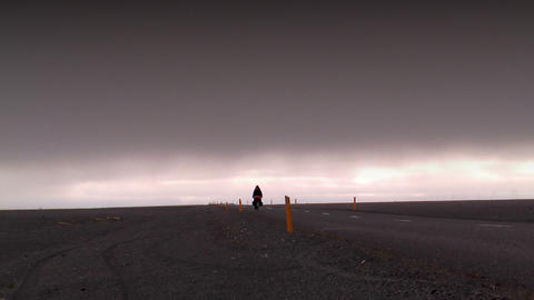 cyclist in deserted landscape in iceland Stock Video Footage