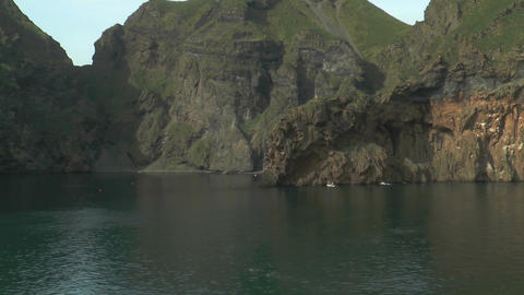 passing cliff coast at westman islands in iceland Stock Video Footage