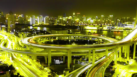 Time lapse of traffic lights trail & vehicles on overpass bridge at night Animation