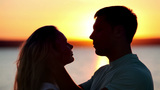 Couple Kissing at Sunset Footage