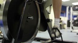 Female Legs Training on Gym Bicycle Footage