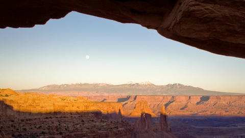 (1132) Mesa Arch Canyonlands Sunset Full Moon Over Utah Mountains Footage