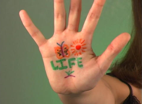 "Beautiful Teen Girl Shows ""Life"" on Her Hand Stock Video Footage"
