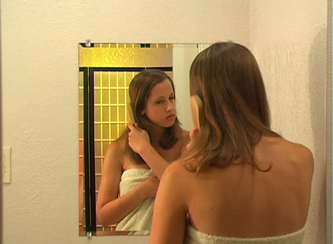 Sad Teen Girl Brushes Her Hair (2a) Stock Video Footage