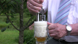 Pouring beer into a stein 1 Footage