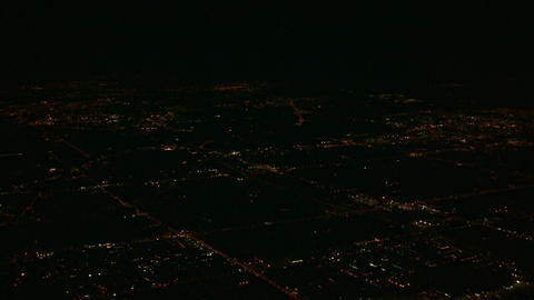 City scenic at night from above the clouds (High Definition) Stock Video Footage