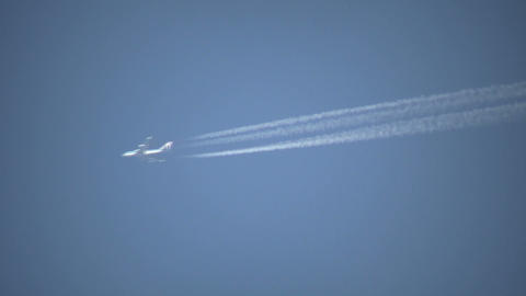 Closeup of Condensation trails from a passing airplane... Stock Video Footage