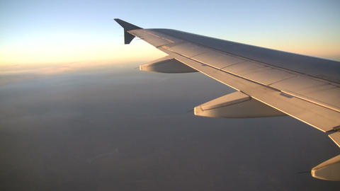 View of plane's wing from above the clouds (High Definition) Footage