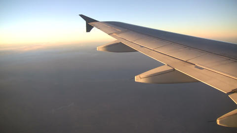 View of plane's wing from above the clouds (High Definition) Stock Video Footage