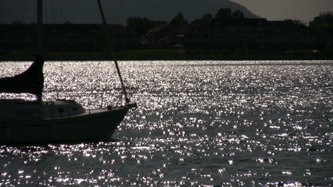 Sailboat sails through the sparkling water (High Definition) Stock Video Footage