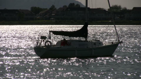 Sailboat sails through the sparkling water (High Definition) Footage
