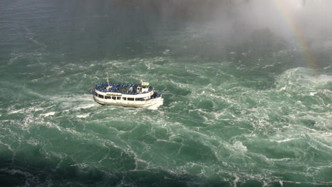 Tourists stand on tour boat near Niagara Falls (High Definition) Footage