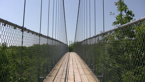 Suspension bridge gently sways in the wind (High Definition) Stock Video Footage