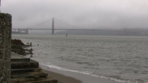 Distant view of the Golden Gate Bridge on foggy day Stock Video Footage
