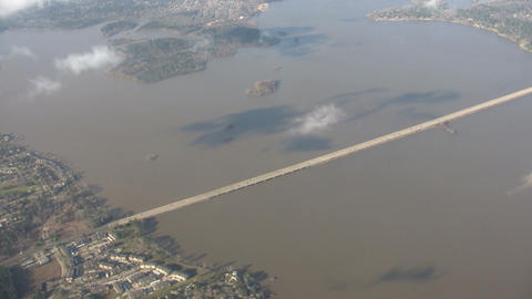 Aerial shot of long highway traffic bridge crossing over... Stock Video Footage