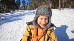 Boy On Sledge stock footage