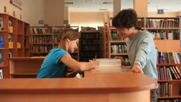Boy Returning Books in Library Footage