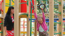 Little Girl Swinging on Rings Footage